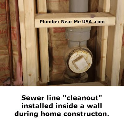 Sewer line cleanout installed inside a wall during home constructon.