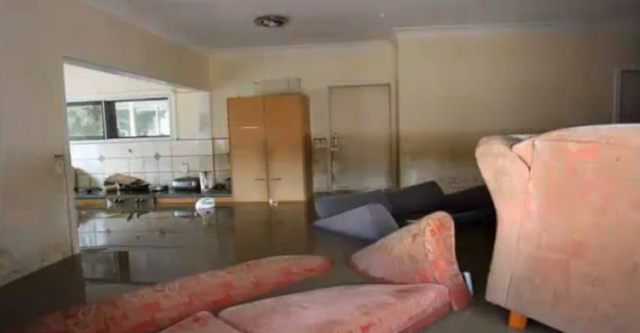 """Flooded living room and kitchen. Your local """"plumber near me"""" will stop the leak and begin water damage restoration immediately. Call 1-888-548-3652"""