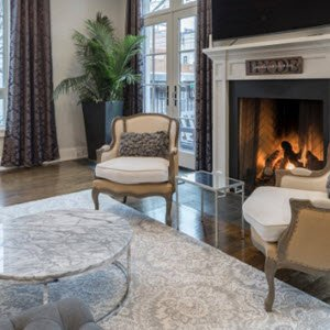 Call a gas plumber to install a natural gas fireplace in the living room.