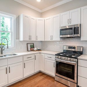 Remodeled kitchen with new natural gas stove. A licensed natural gas plumber is required to install gas appliances.